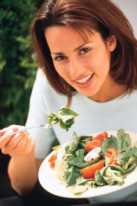 Womean Eating Salad